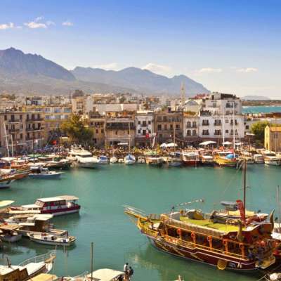 View of a busy historic harbour and the old town in Kyrenia (Girne) on the Island of Cyprus.
