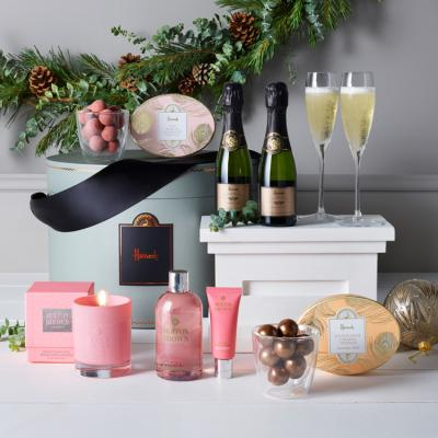 Relax and rejuvenate with the Pamper Hamper, priced at £150. Filled with indulgent treats including rose scented Molton Brown body wash, hand cream and a scented candle, the hamper is complemented perfectly with Harrods Champagne and Marc de Champagne truffles.